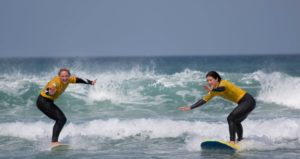 surfing lessons with pro surfer and celebrity personal trainer Tehillah Mcuinness in Cornwall